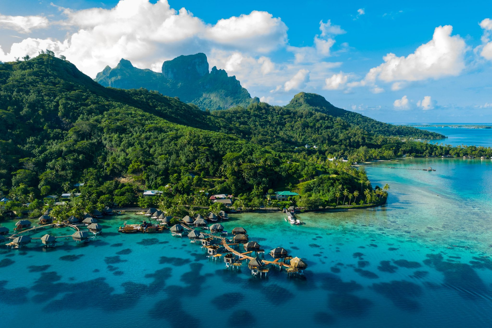 Bora Bora aerial drone image of travel vacation paradise and overwater bungalows
